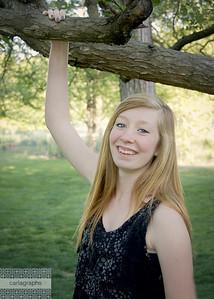 Tess Hand on Branch Big Smile-