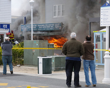 12:32:06  Owner Bill Gibbs watches his business burn.