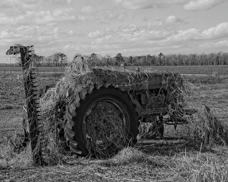 Tractor beside house, Fairfield, NC