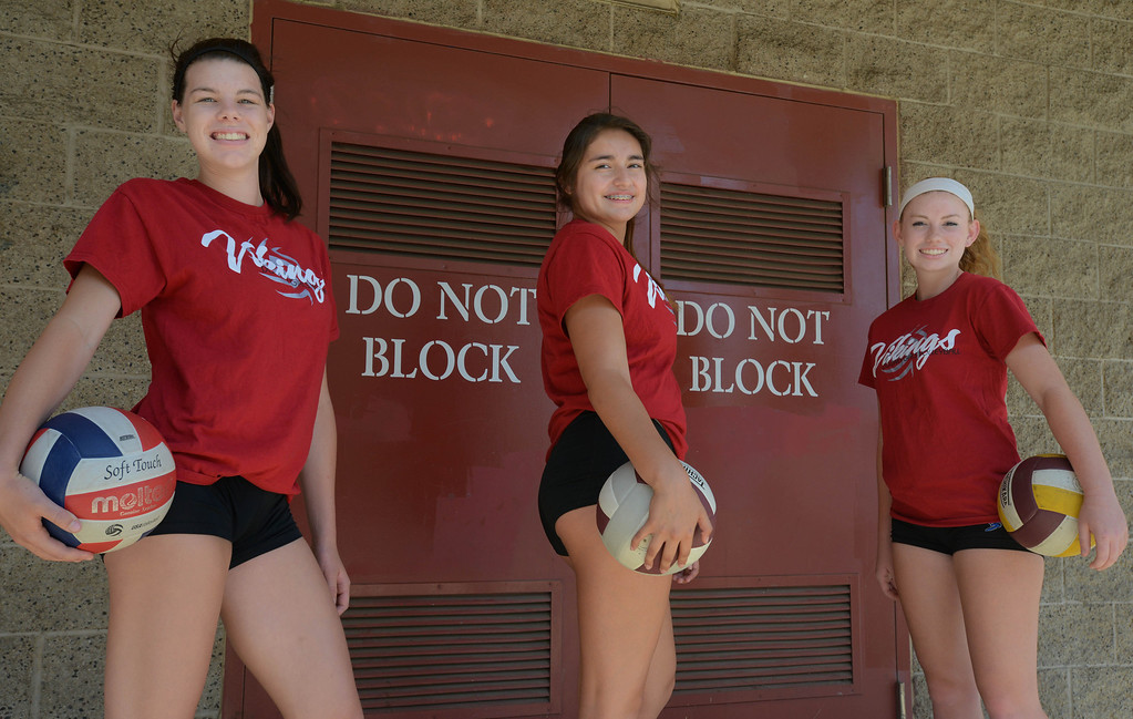. Downey girls volleyball players Kimberly Schnars, left, Bela Gamboa, center, and Amy Crowell. Downey, CA. on September 11, 2013.(Photo by Sean Hiller/Press Telegram)