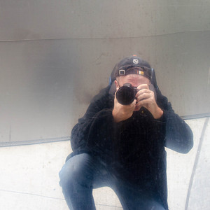 I thought I would snap a shot of this guy taking pictures. I should have washed the wall first. :-)