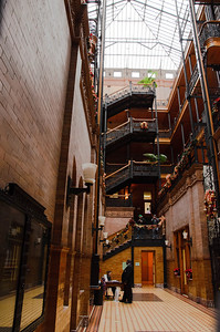 Inside the Bradbury Building. The public is not allowed past the landing deck at the top of the first flight of stairs. The architecture is stunning.