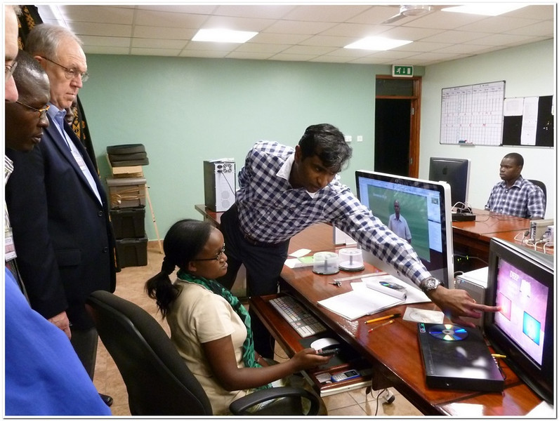 Dr. Larry Evans watching a demonstration of the signed video materials being prepared at the DOOR center near Nairobi, Kenya in Feb. 2012