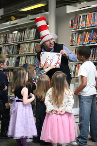 03Mar2013__ Marvin Krislov, President of Oberlin College, in stripped top hat, reads to the children for Dr. Suess Day at the Oberlin Public Library. photo by Ray Riedel
