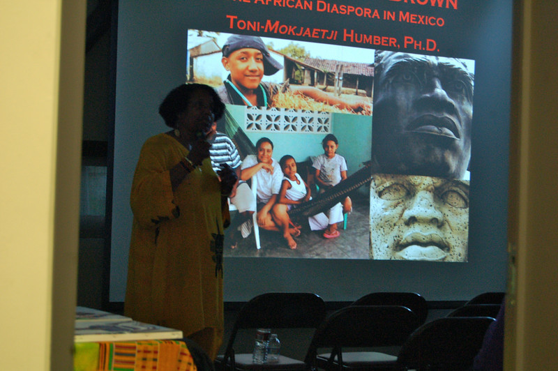 """Dr. Toni-Mokjaetji Humber, Ph.D, addresses Dr. Kwaku's Class with her dynamic presentation: """"When Black is Brown."""" Her powerpoint depicts her many travels into Mexico researching artwork, statues, caves, museums and the people. She brings a mini-museum with her or artifacts and photos as well.  Dr. Kwaku can refer you to her if your organization would like to book her for a lecture.  <a href=""""http://www.DrKwaku.com"""">http://www.DrKwaku.com</a>"""