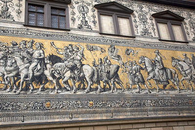 The Fürstenzug.  Largest porcelain mural in the world.  Shows procession of rulers of Saxony from the 12th to 19th century.