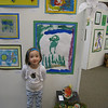 The proud artist in front of one of her pieces that was hung in the gallery.