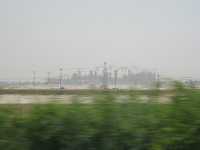 In the distance is Meydan the new development next to Nad Al Sheba racecourse where the Dubai world cup is held.  In the new development there's going to be a hotel, more than 10 restaurants, the relocation of Godolphin Gallery, and will also be the headquarters for Dubai Racing Club. THere will be a museum, covered car parking for 10,000 and a four-kilometre canal running from Dubai Creek to the racecourse.