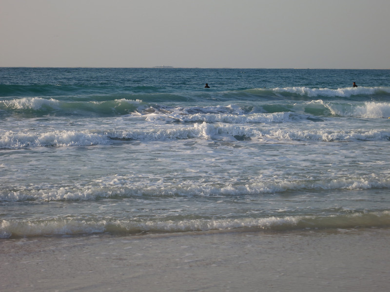 A beach on the Persian Gulf. . . you can barely make out an island on the horizon.  It's a man-made island several km off shore that's part of a complex designed to look like the world.  Each property goes for between 10-100 million bucks.