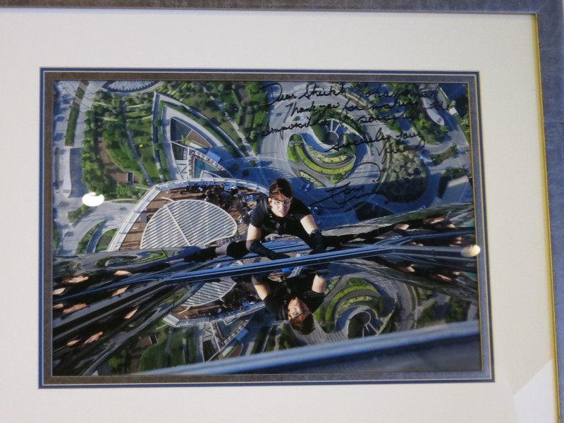 Tom Cruise jumped off the big tower for part of his movie MI4.  He tanked the owner with this shot and autograph.