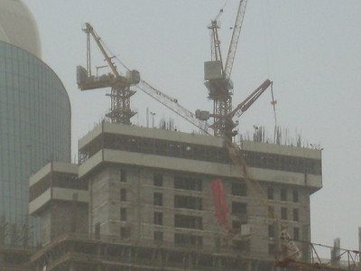 Collapsed crane on a building on the road that runs parallel to Sheik Zayed Road (don't know what its called, its the road that runs behind the Fairmont)..