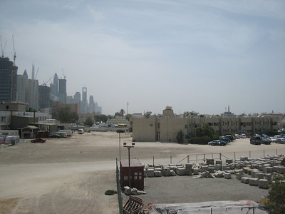 The tall buildings are on Sheikh Zayed Road.  The demolition area runs parallel to SZR for 10kms in a 2km wide strip starting from just behind where this photo was taken.  The block to the right contains 42 apartments and there are also 18 villas.
