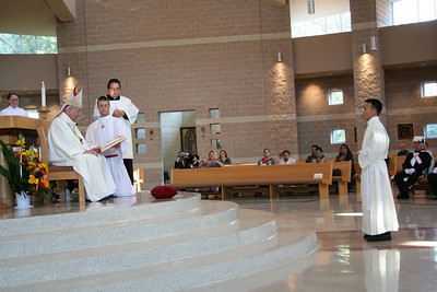 Duy comes forward as he is presented for ordination.