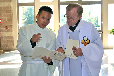 Dn. Duy and Fr. Bob just before the start of Mass.