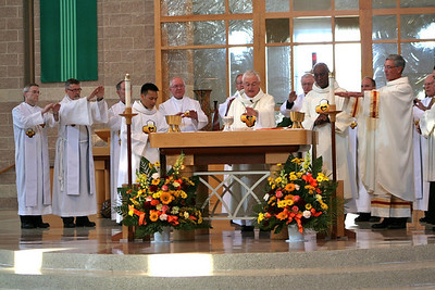 SCJs gather around the altar for the Eucharist.