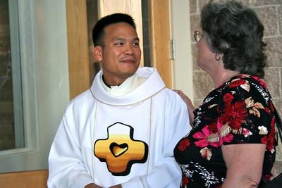 Meeting parishioners.