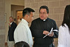 Fr. Jack Kurps goes over last minute details with Dn. Duy.