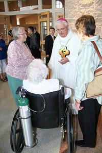 Bishop Latino visits after Mass.