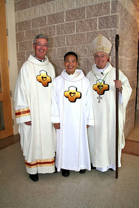Fr. Tom Cassidy, provincial superior, Dn. Duy Nguyen and Bishop Joseph Latino.