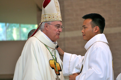 Bishop Latino with the new deacon.