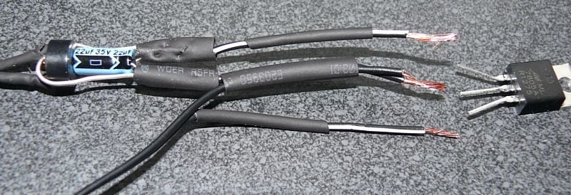 This shows how the voltage regulator, on the right, will link the DC supply to the wires that will connect to the speakers.