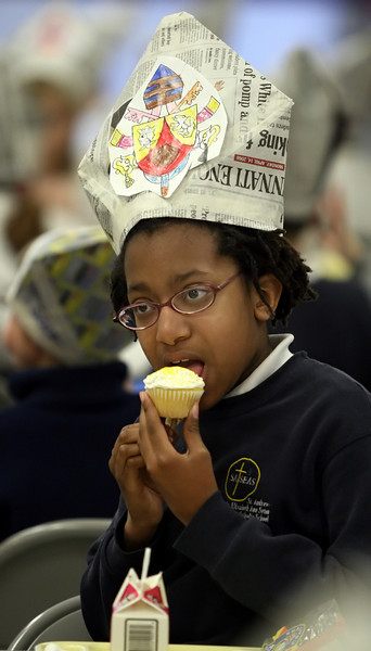 Morgan Powers one of the students at the Seton campus of St. Andrew-St. Elizabeth Ann Seton School in Milford celebrated Pope Benedict's visit to the US and his 81st birthday Wednesday, April 16th by singing happy birthday and eating cupcatkes. (Photo by Tony Tribble)