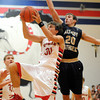 THIRD TEAM<br /> Kevin Daugherty<br /> Effingham<br /> Junior forward<br /> 2013-2014 STATISTICS <br /> 10 ppg, 3.5 rpg, 2 apg <br /> AWARDS/HONORS <br /> All-Apollo Conference, All-Effingham/Teutopolis Christmas Classic
