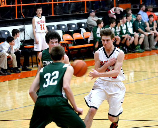 Altamont's Garrett Ziegler throws a no-look pass during an NTC tournament game with Stew-Stras on Jan. 29, the game in which he cleared the 1,000 point mark.
