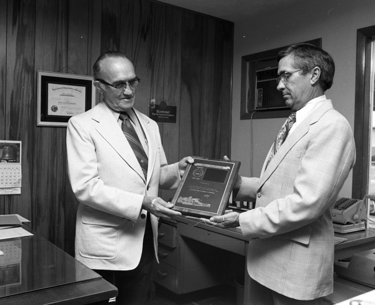 Vern Valish and JH. Lowell Marvin, Special Agent for Economy Fire & Casualty Company.