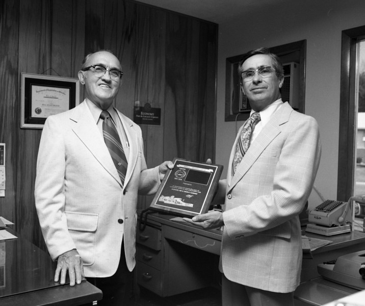 Vern Valish and J. Lowell Marvin, Special Agent for Economy Fire & Casualty Company.