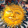 Our new SUN! We'll put it on the house, as soon as Roberto can do so. It was made by Paolo, l'Artigiano, in Manarola!
