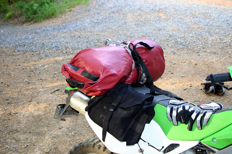 I had most awesome motorcycle luggage. I had a canoeing dry bag held on with climbing slings and caribiners, and saddle bags fashioned from some pouches I found at the army store. I could have gotten them in olive drab, but I thought the Nato Black was sportier.