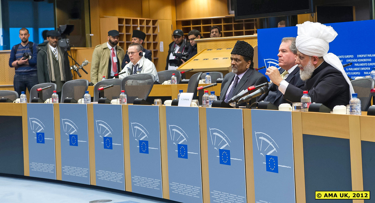 EU3_0127: Press Conference - In response to a question from the BBC about Islam's role in the world, Hadhrat Mirza Masroor Ahmad explained that Islam's core message was of peace. (PRESS RELEASE)
