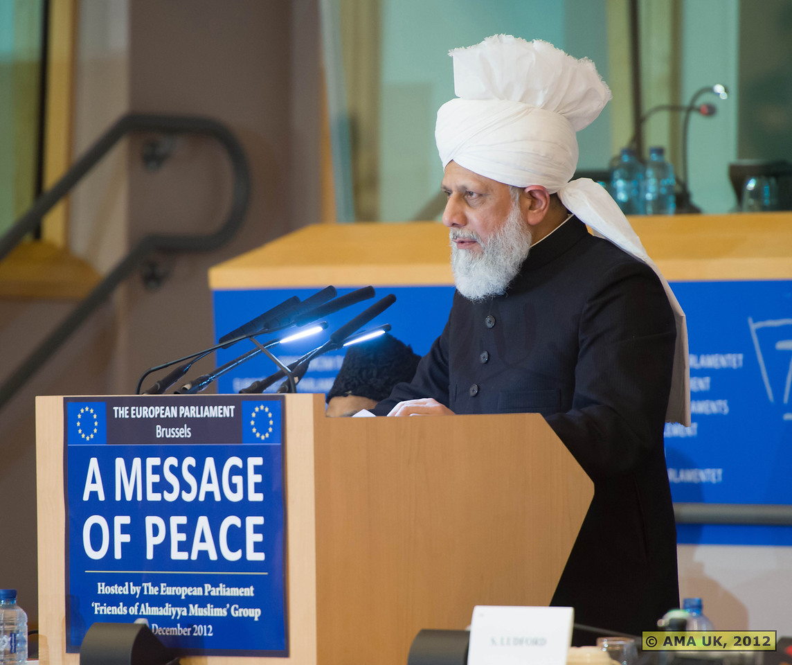 """EU6_1064: Hadhrat Mirza Masroor Ahmad said: """"Governments need to make policies that establish and protect mutual respect, through which hurting the sentiments of others or causing them any type of harm should be outlawed. With regard the immigrants, they must enter with a willingness to integrate with the local people, whilst the locals should be ready to open their hearts and display tolerance."""" (Press Release)"""