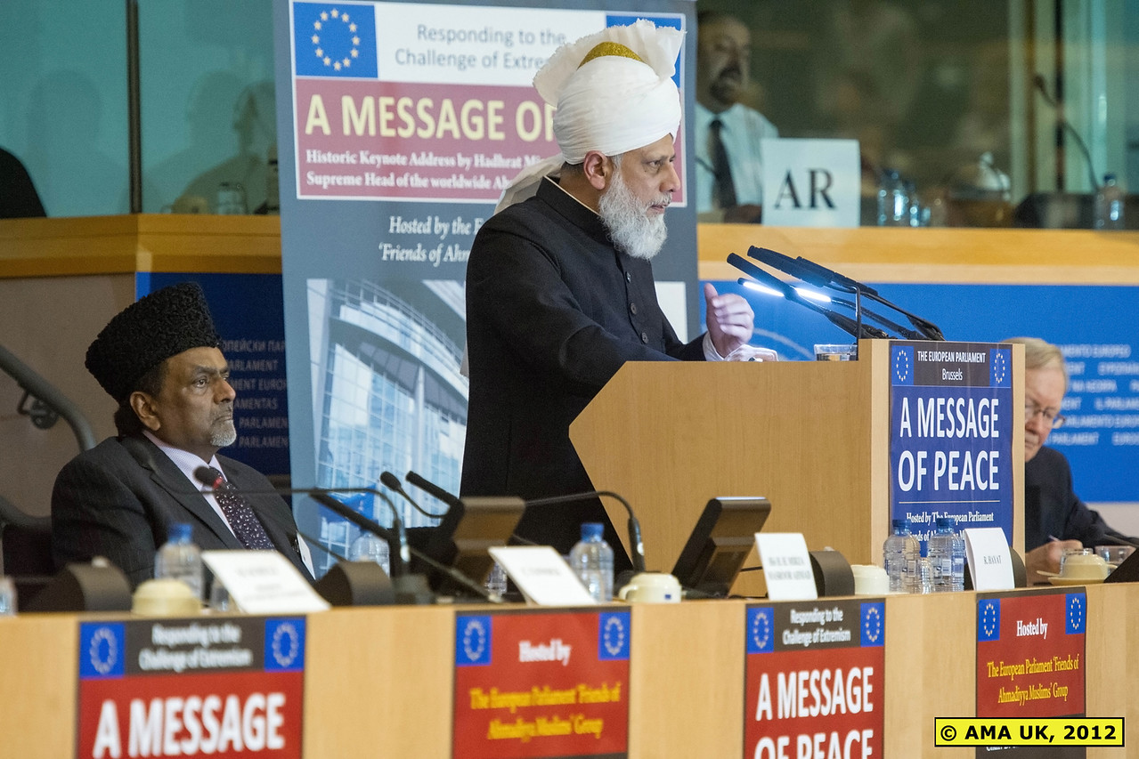 """EU3_0276: Hadhrat Mirza Masroor Ahmad concluded by calling for justice and equality. He said: """"Always remember that peace can only be established by helping both the oppressed and the oppressor in a manner that is completely impartial, free from vested interests and devoid of all enmity. Peace is made by giving all parties an equal platform and playing field."""" (PRESS RELEASE)"""