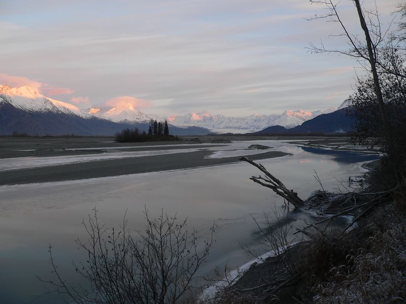 Last rays of the setting sun on the peaks lining the Knik River