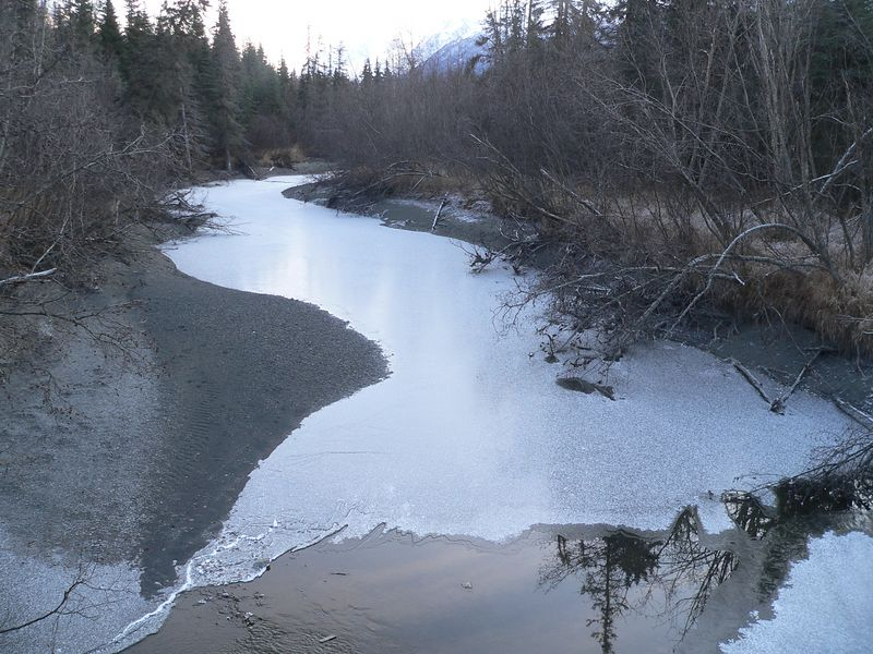 This slow flowing stream near the Eagle river is starting to freeze over and is speckled with snow from an earlier flurry.