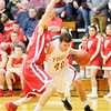 Don Knight / The Herald Bulletin<br /> Alexandria's Blaize Kelly drives the baseline as he is guarded by Frankton's Brady Ashton on Friday.