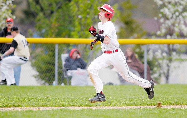 Don Knight | The Herald Bulletin<br /> Frankton's Jon Betz scores on a throwing error as the Eagles hosted Daleville on Wednesday.