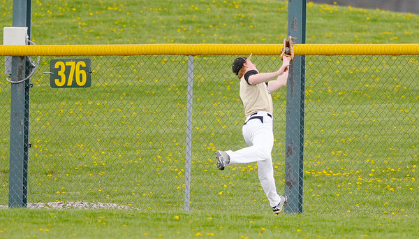 Don Knight | The Herald Bulletin<br /> Daleville center fielder Corbin Maddox catches a fly ball at the fence as Frankton hosted the Broncos on Wednesday.