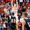 Don Knight / The Herald Bulletin<br /> Frankton senior Aaron Korn shoots over Sheridan's Chris Roberts during senior night on Friday.