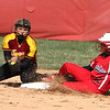 Photo by Chris Martin<br /> Frankton's Kyleigh Garner beats the throw to 2nd against Alexandria