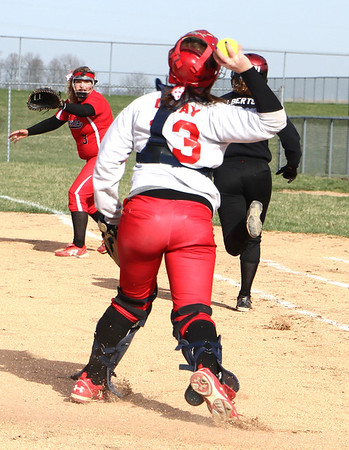Photo by Chris Martin<br /> Frankton's Lexi Gray throws out Alexandria's Makayla Alberts Wednesday in the County Softball Tournament.