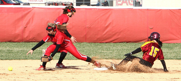 Photo by Chris Martin<br /> Alexandria's Mariah Cook slides to beat the throw at 2nd base against Frankton Wednesday in the County Tournament