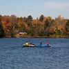 Some kids enjoying the lake in fall