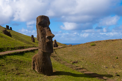 Starting in December 1862, slave traders from Peru conducted a series of violent abductions capturing or killing around 1500 of the 3000 remaining inhabitants of Rapa Nui over the course of several months.  International protests led by Bishop Florentin-Etienne Jaussen of Tahiti forced the slave traders to give up their slaves in the autumn of 1863.  Unfortunately most of the captured Rapa Nui had died of Dysentery, Tuberculosis, and Smallpox. Only about a dozen Rapa Nui returned from Peru.  The dozen who returned brought with them a smallpox plague.  Some claim the island's population was so devastated by smallpox that the dead were buried in mass graves.  To commerate the suffering of the Rapa Nui during the 1860s, several Moai on the slopes of Rano Raraku were marked with pock-like holes.  TQ 2010 memory book image 9 of 11