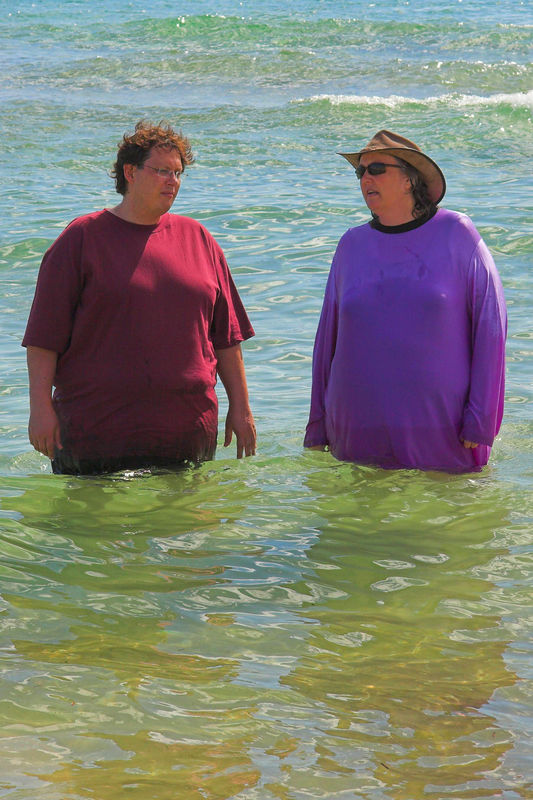 Dennis and Janet, chatting in the water. Solving the ills of the world?