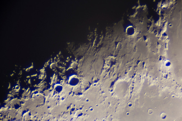 Terminator line on the first quarter moon
