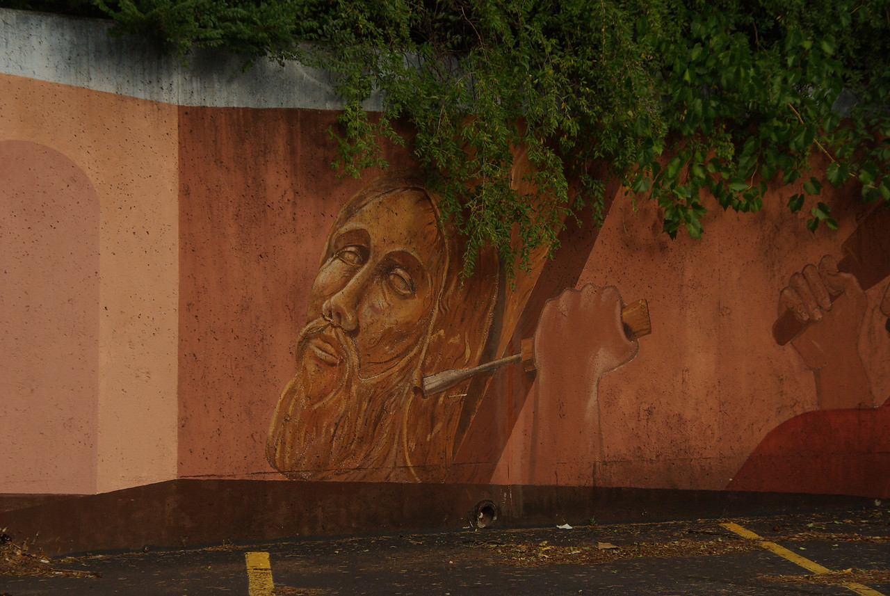chiseling the crucified mural
