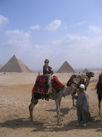 Gay rides camel near the Great Pyramids--Cairo, Egypt